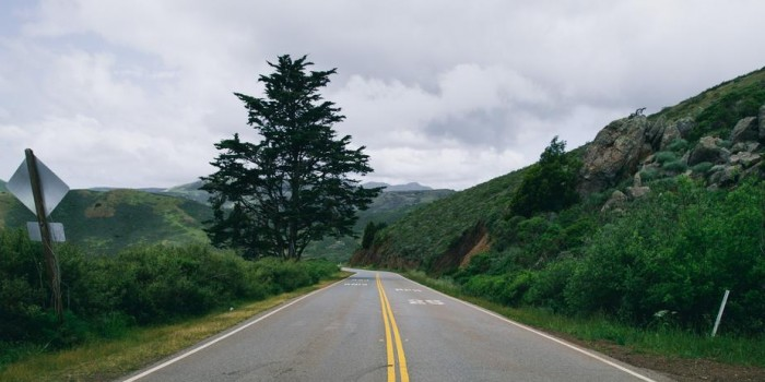 crosswalk-and-road-through-grassy-hills_925x
